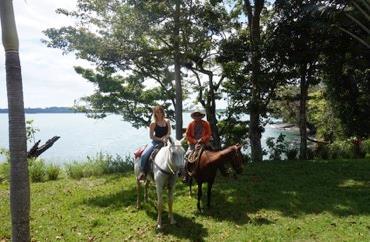 Horse trekking at Isla Bocco Brava in Panama.